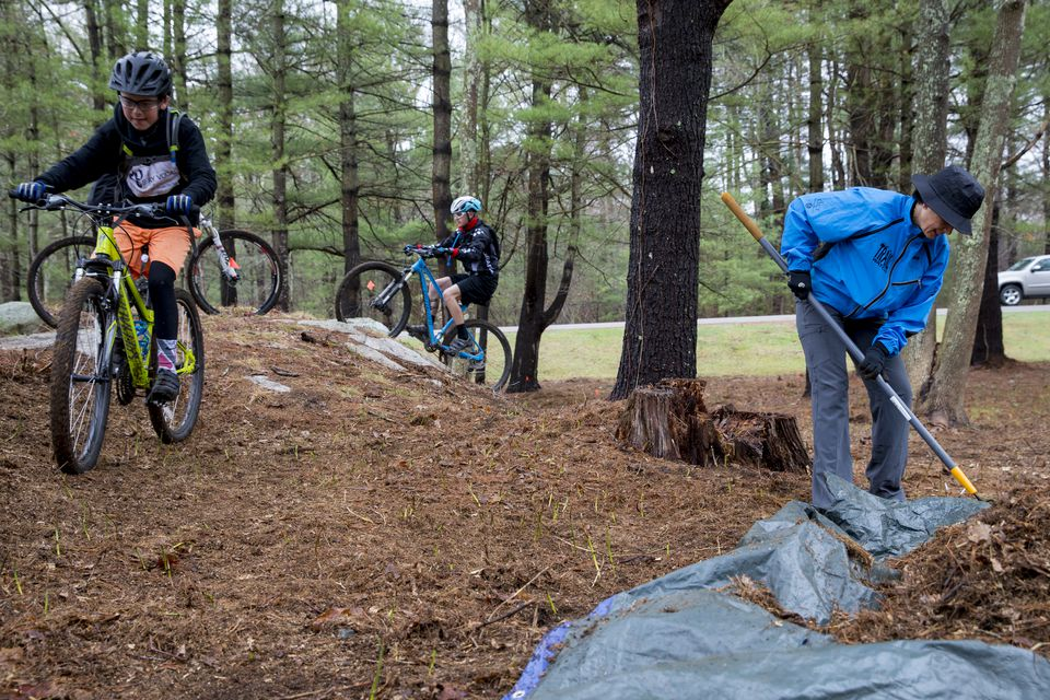 Brayden Kain (left), 12, of Whitman, and other cyclists took a test ride on a BMX track at Wompatuck State Park built by Pam Johnson (right) and other Friends of Wompatuck volunteers.