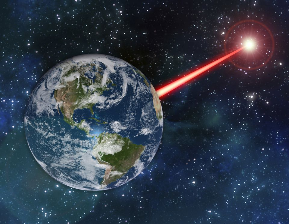 An MIT study proposes that laser technology on Earth could emit a beacon strong enough to attract attention from as far as 20,000 light-years away.