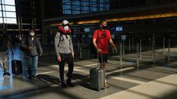 Travelers in the Tom Bradley International Terminal at Los Angeles International Airport.