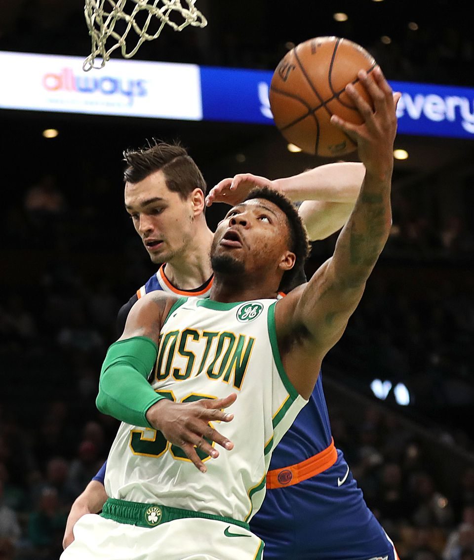 Marcus Smart beat the Knicks' Mario Hezonja for a layup in the first quarter.