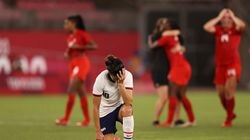 American Carli Lloyd took a knee following Canada's 1-0 win over the United States in the semifinal match.