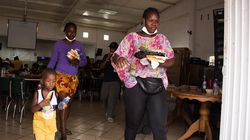 Haitian migrants walked carrying food rations at a migrant shelter and dining rooom where they await their immigration resolution, in Monterrey, Mexico. Haitians who lived for as many as 10 days in squalid conditions under a bridge while confined at the southern US border filed a civil rights complaint Monday.