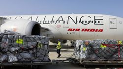 Workers load medical aid to be flown in an Air India plane to India.