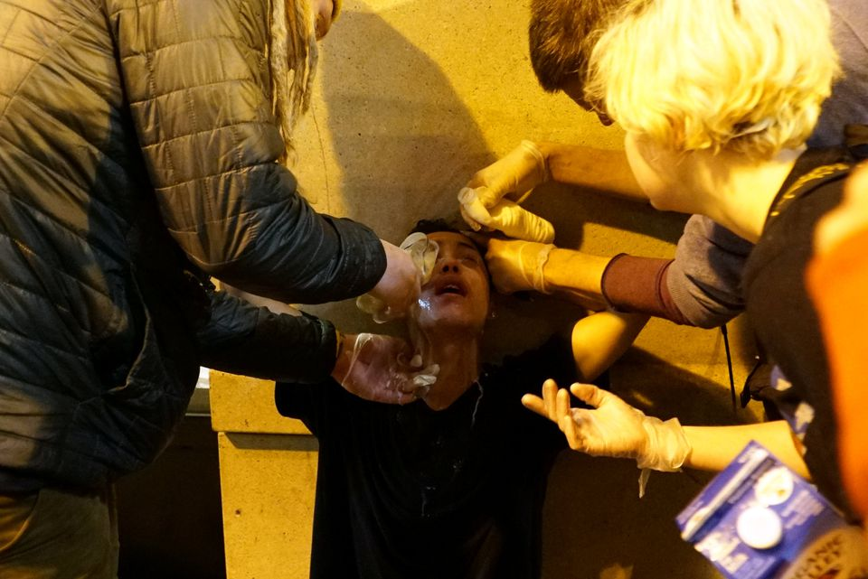 A demonstrator is treated for dispersant exposure during a protest against the election of Republican Donald Trump as President of the United States in Portland, Ore., Friday.