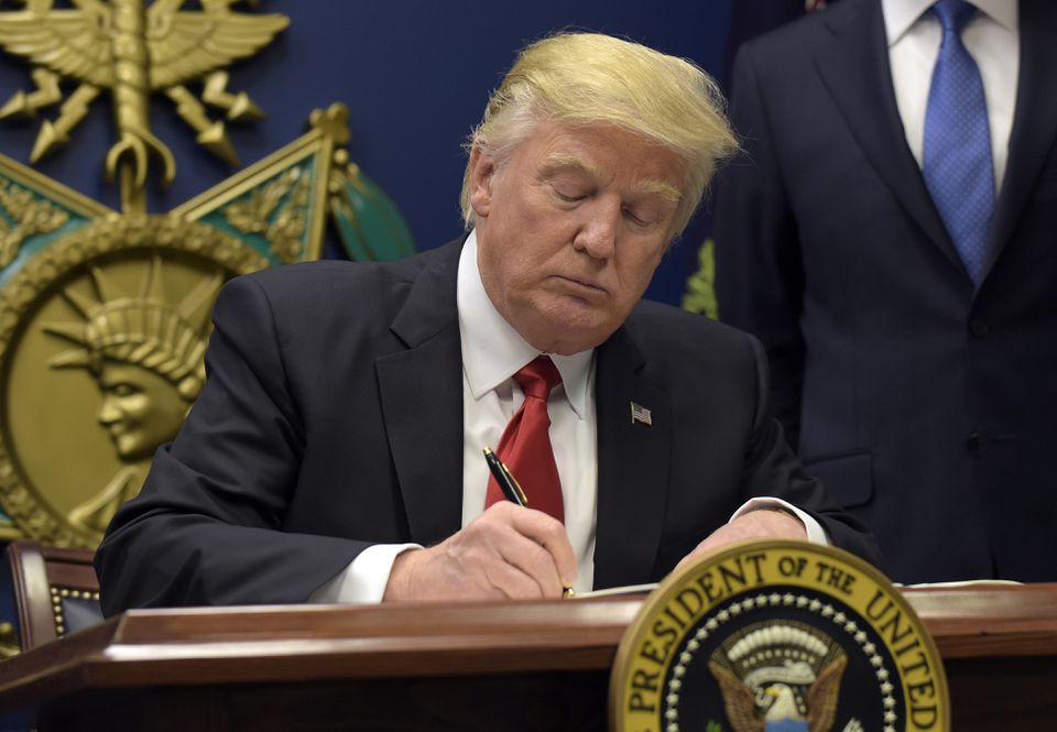 President Trump signed an executive order severely limiting immigration from seven Muslim-majority nations on Friday.