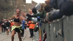 During the 111th running of the Boston Marathon an enthusiastic runner gets high-fives from the crowd as she makes her way through Cleveland Circle in Brookline in 2007.