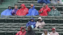 Fans wore rain ponchos and parkas while waiting for a baseball game between the Miami Marlins and the Boston Red Sox on Sunday.