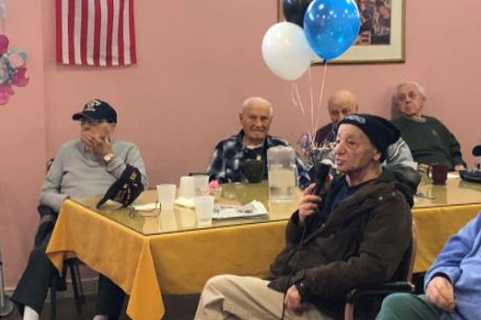 """Peter Nazzarro (front center) sang """"Happy Birthday"""" and """"16 Candles"""" to 101-year-old Tony Barrasso (back center)."""