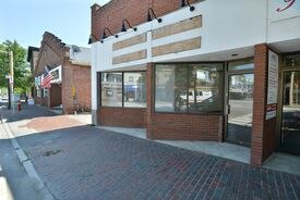 Town officials say they have little authority to do anything about the vacant storefronts.