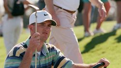 In this Jan. 11, 1998 photo, Casey Martin holds his putter while sitting in a cart after he won the Nike Lakeland Classic at Grasslands Golf and Country Club in Lakeland, Fla.