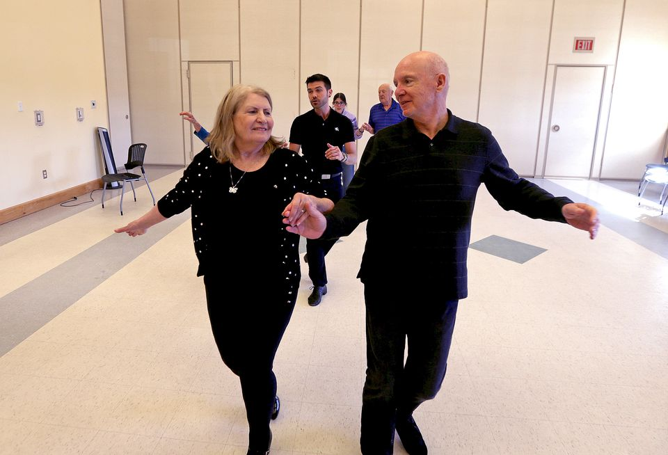 """Dance Instructor J Michael Winward, of """"Steps In Time,"""" center rear, led a """"Naughty Nookers"""" dance class at Plymouth senior center."""