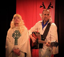 "Stephen Russell as God and and Nancy E. Carroll as God's wife, Marilyn, in ""Return of the Winemaker."""