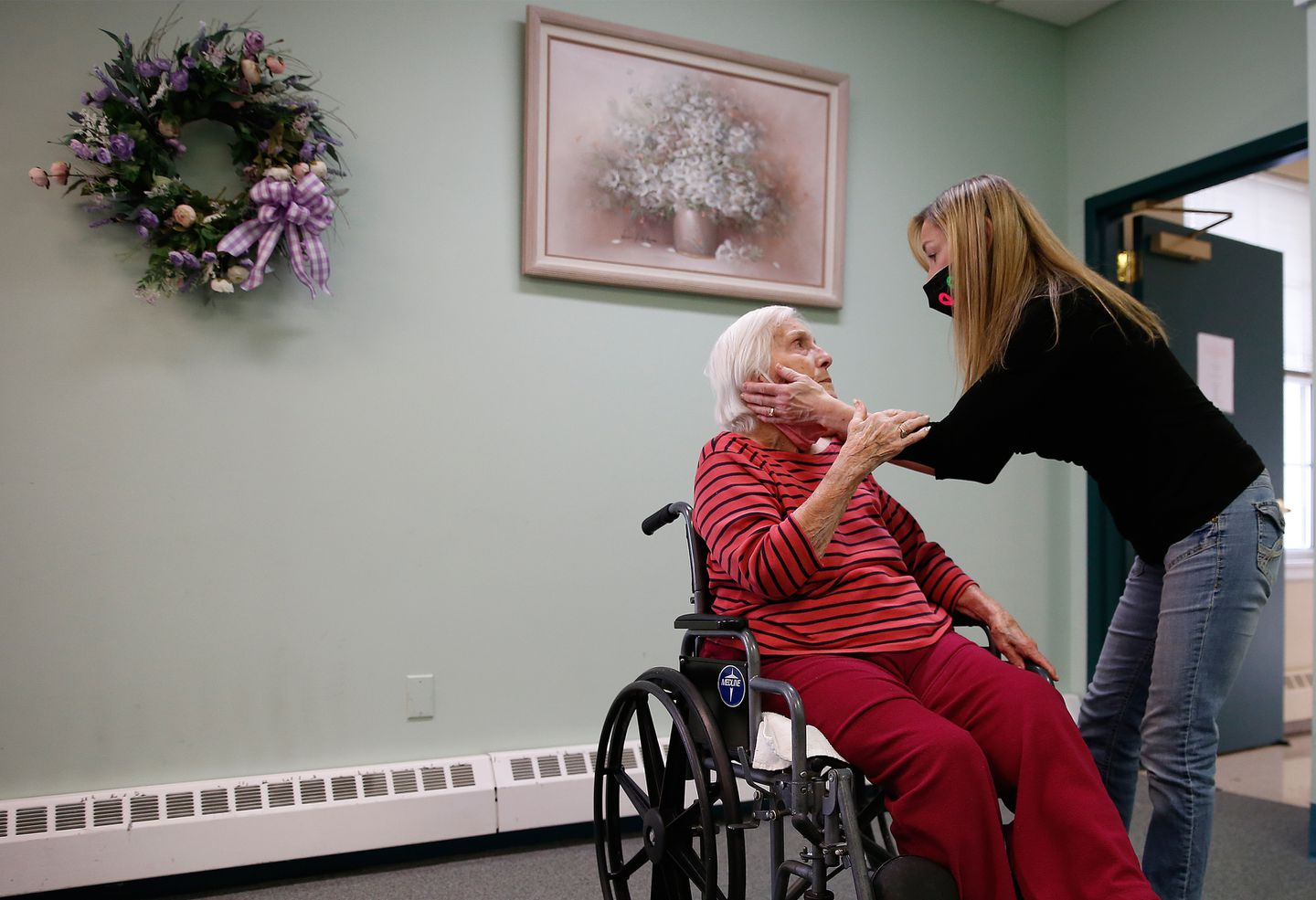Kate Cunningham told her 88-year-old mother, Sheila McCabe, that she loves her after visiting with her at the Copley at Stoughton nursing home. McCabe recovered from COVID-19 and is now vaccinated.