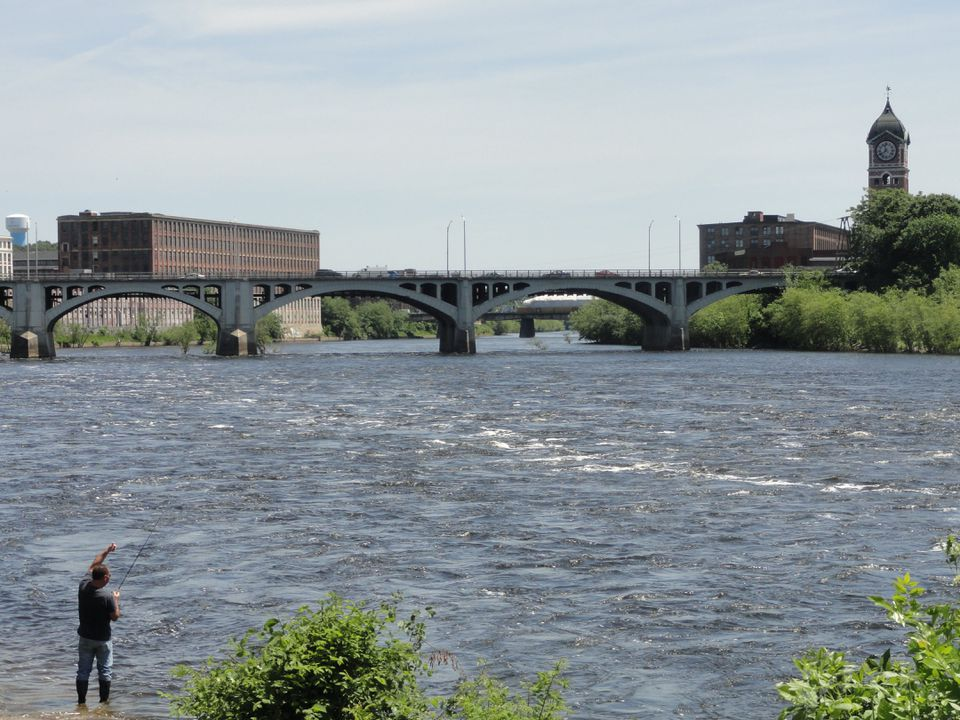 An angler on the Merrimack River in downtown Lawrence, off Route 28.