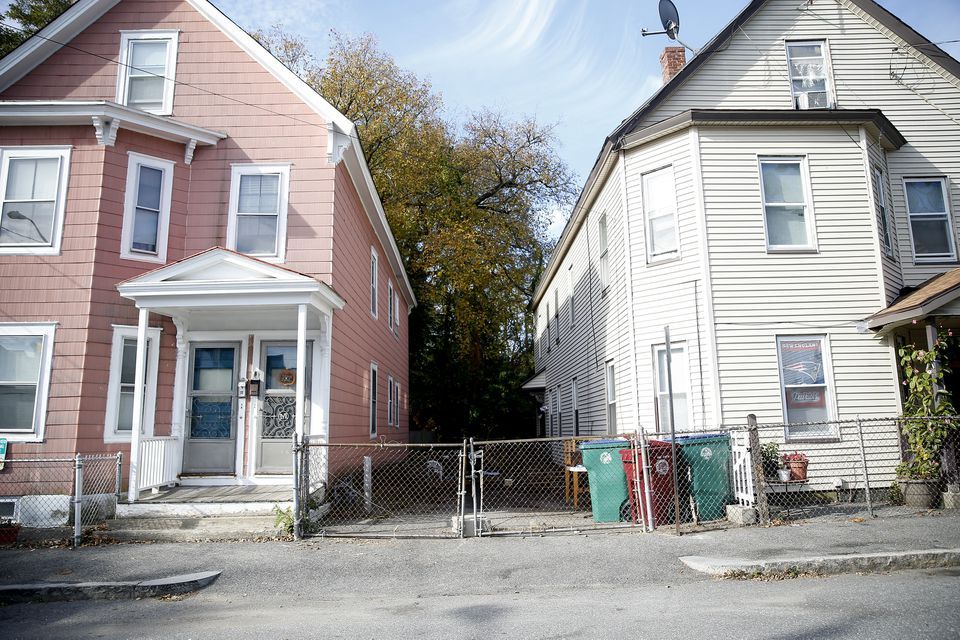 The fenced-in area where a 7-year-old boy was killed by two pit bulls is seen in Lowell.