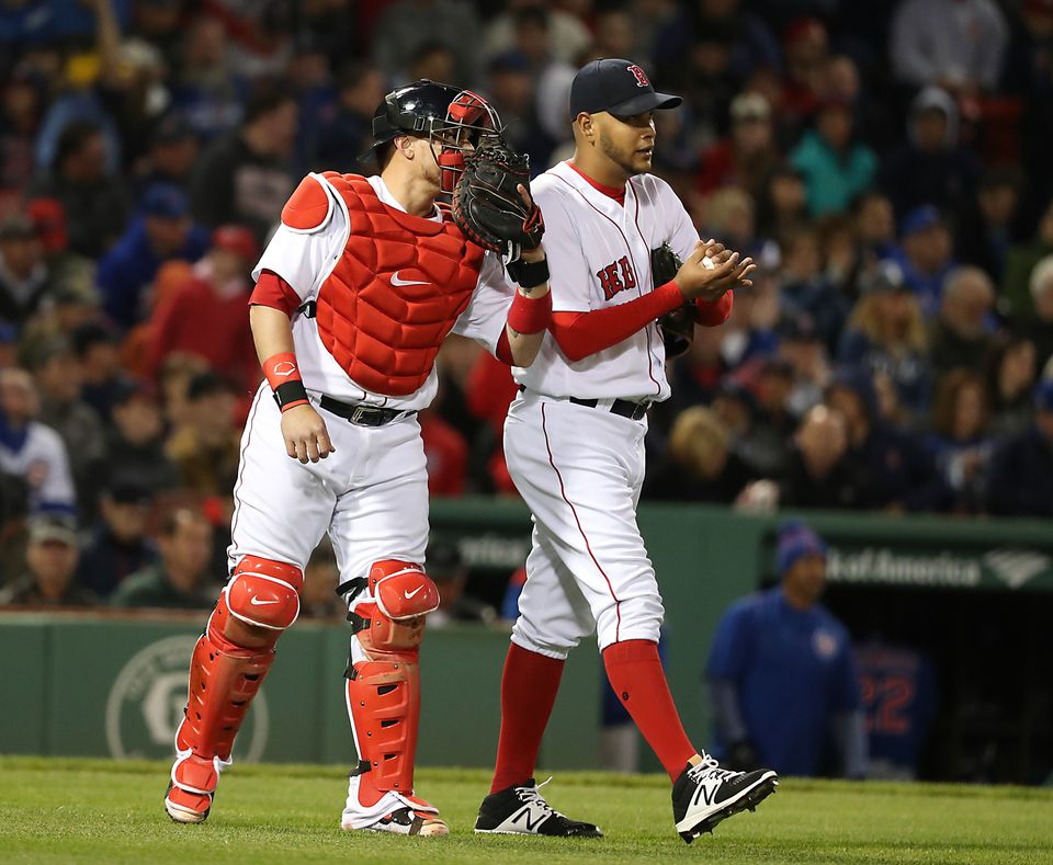 Christian Vazquez talks to Eduardo Rodriguez during the first inning against the Cubs in April.