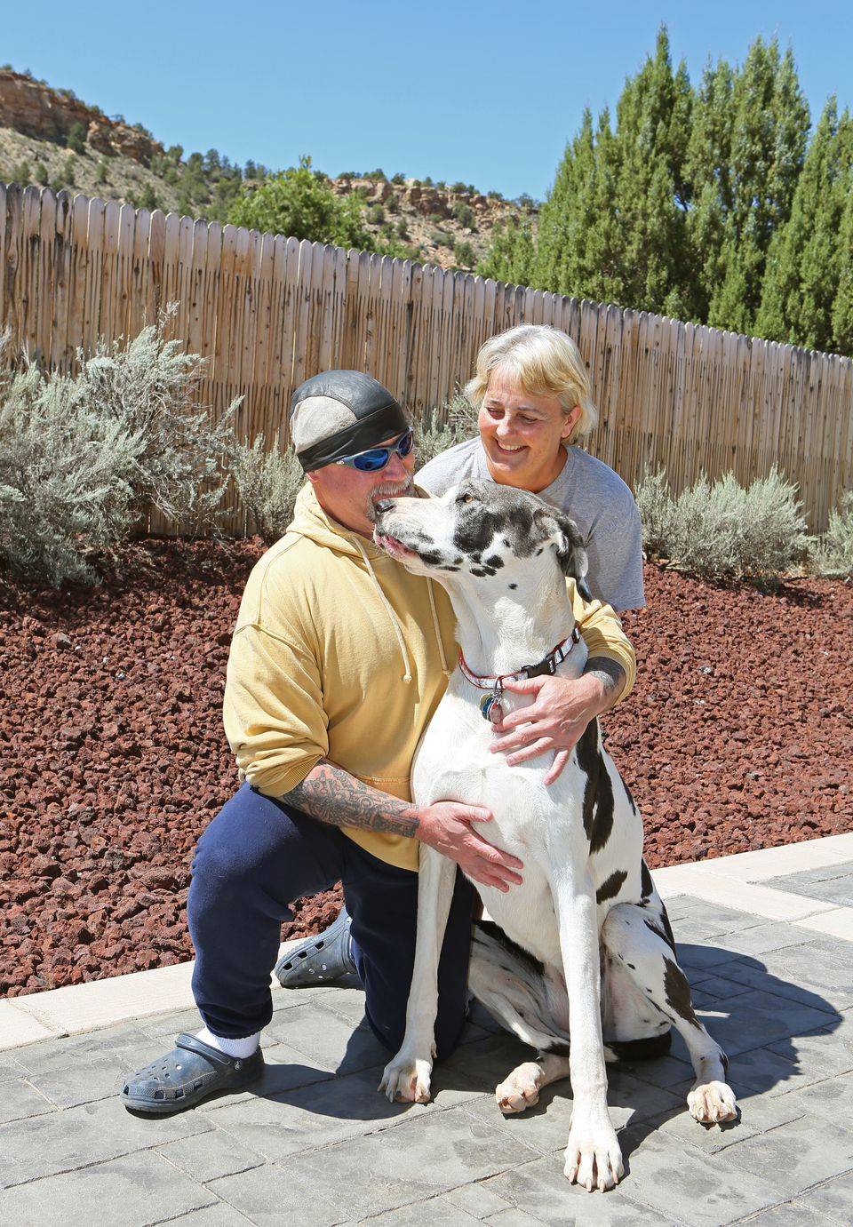 John Moore shared a moment with his wife, Cathy, and their dog outside their Utah home on Thursday.