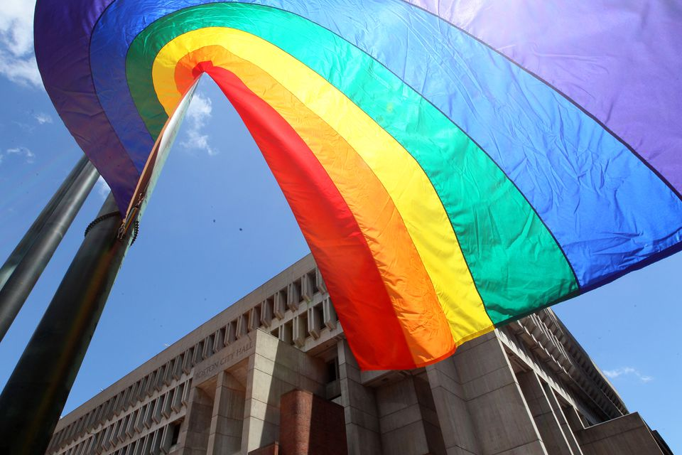 A gay pride flag blew in the wind outside City Hall in Boston.