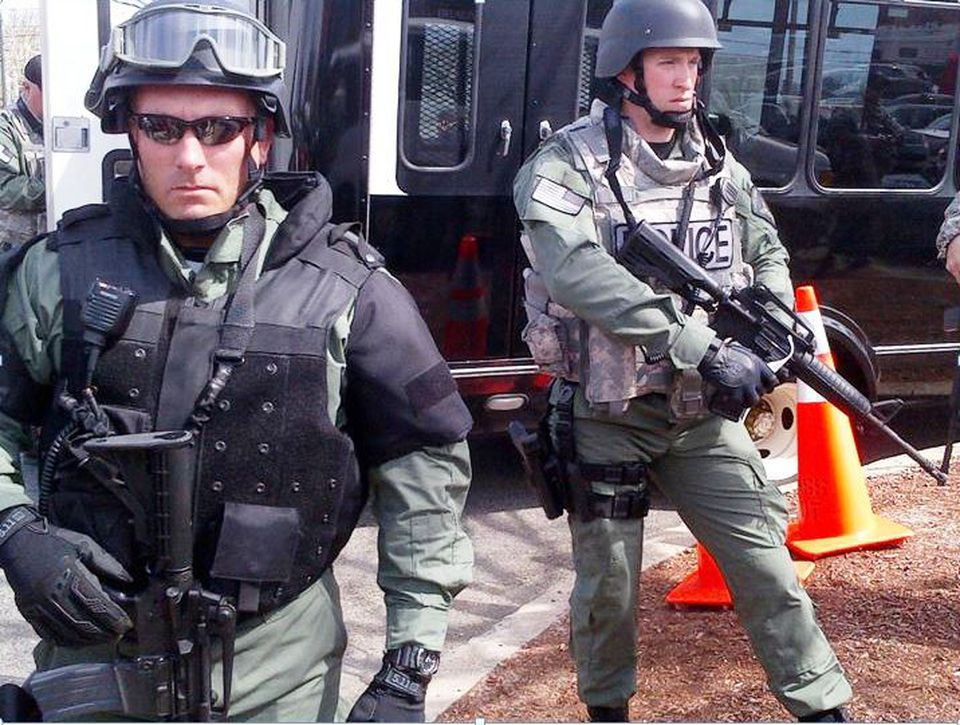 Ipswich Officer Mark Ruggiero (left) and Manchester Officer Joe Archambault (right) were on duty in Watertown.