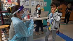 Students were tested for COVID-19 in the lobby of the McGlynn Elementary School in Medford.