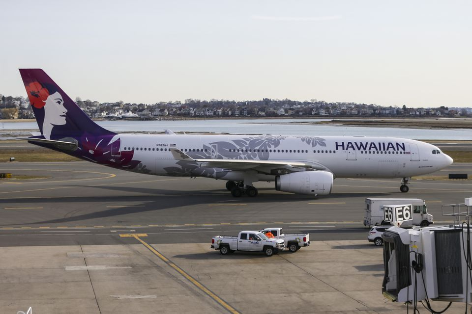 The first direct flight from Logan to Honolulu on Hawaiian Airlines approached the runway on Friday morning.