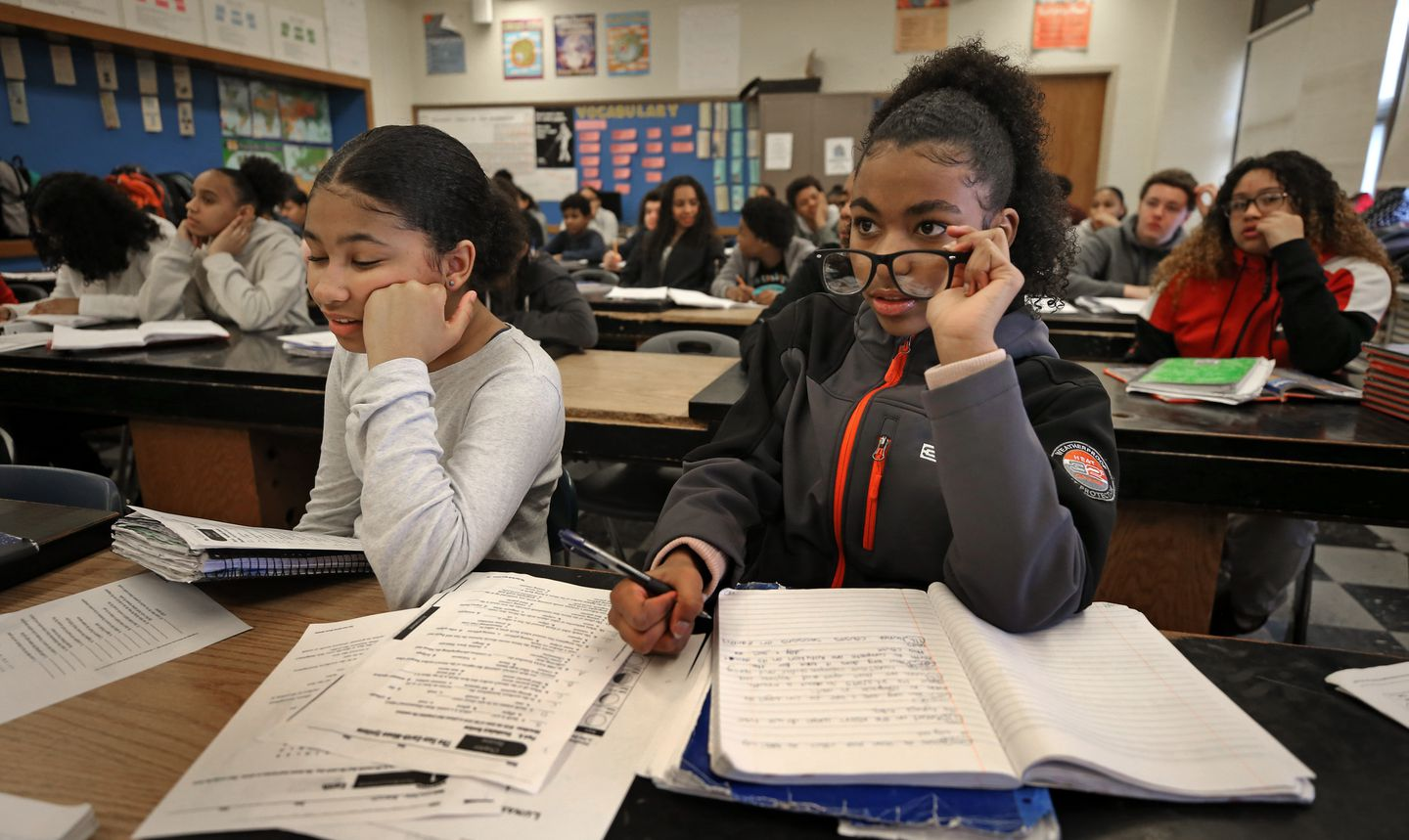 Dailene Barros used glasses she borrowed from Joceline Alexandra Oliveira (left) in an eighth-grade science class at North Middle School in Brockton.
