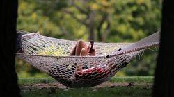 Josh Gluck rests in a hammock on the last full day of summer in Corey Hill Park in Brookline near Coolidge Corner.