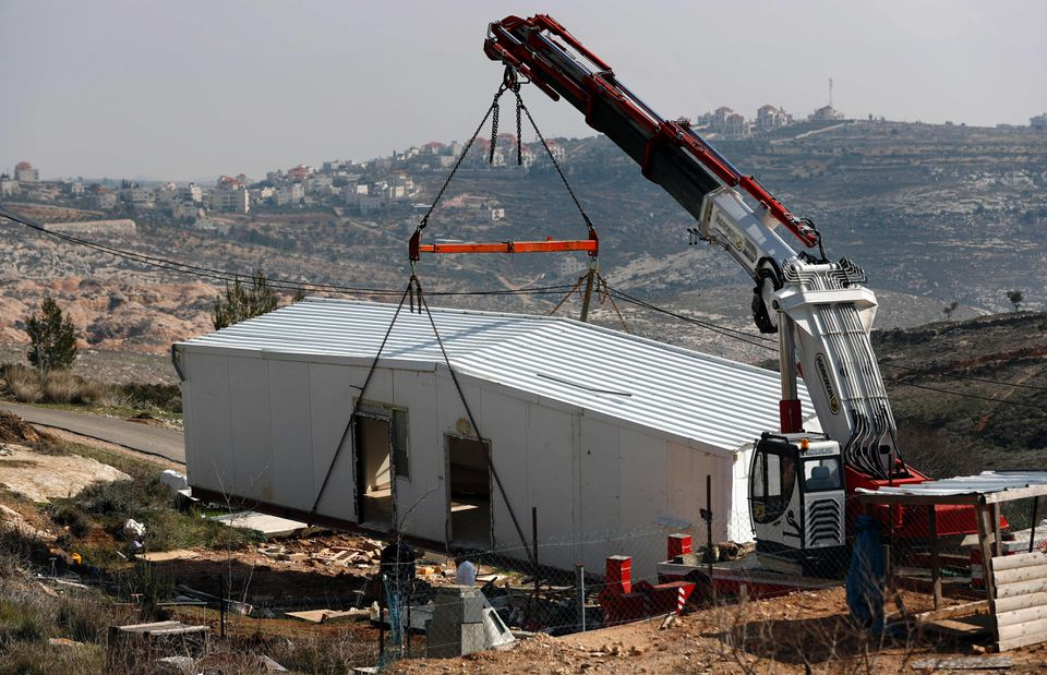 Prefabricated houses were removed from the closed Israeli settlement in Amona, in the occupied West Bank, on Monday.