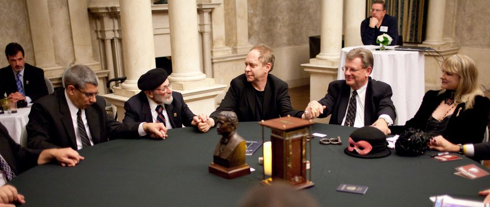 Teller the magician (center) participates in the Houdini seance at the Wistariahurst Museum in Holyoke.