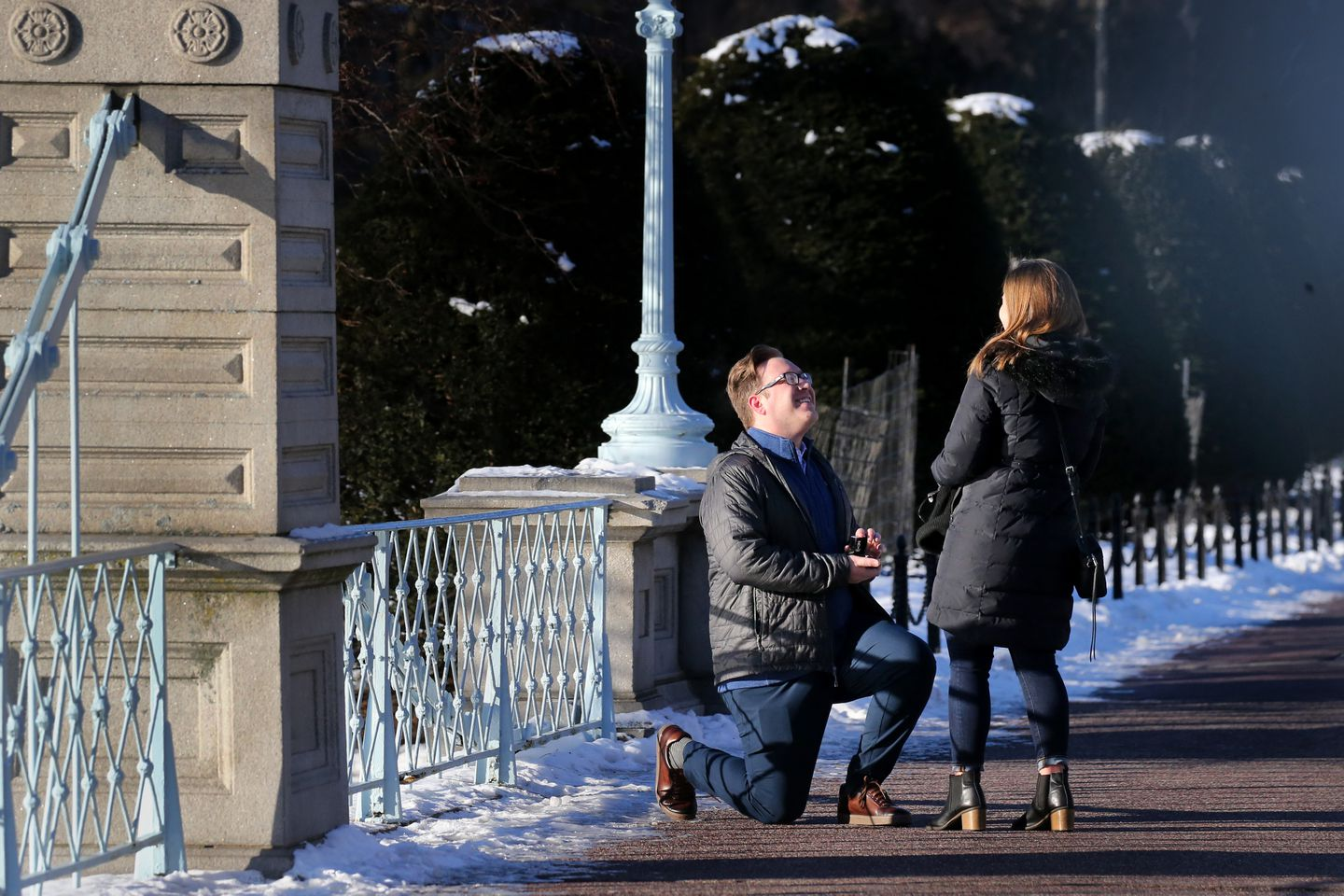 """Mathison Clore kneeled while proposing to Kelly O'Keefe on the bridge at the Public Garden. Clore said it was a cold day to propose but, """"there's no day like the present."""""""
