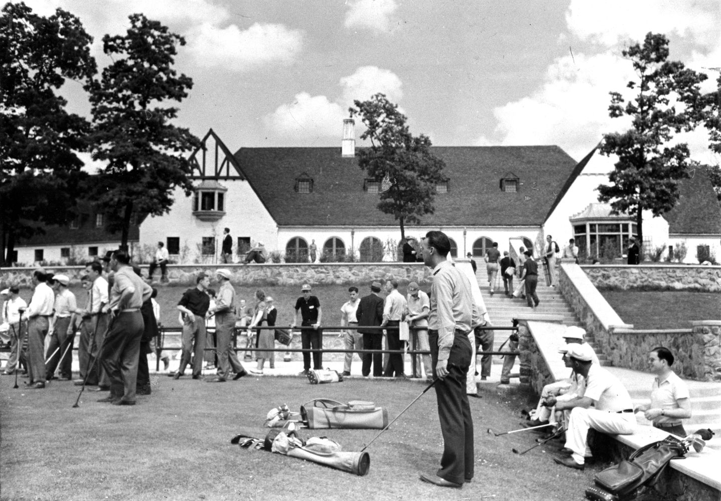 Golfers gathered at the first tee of Boston's newly opened $1 million municipal George Wright Golf Course and country club circa June 1938.