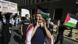 Omar Haidar led a chant while marchers passed through Copley Square in Boston Saturday.