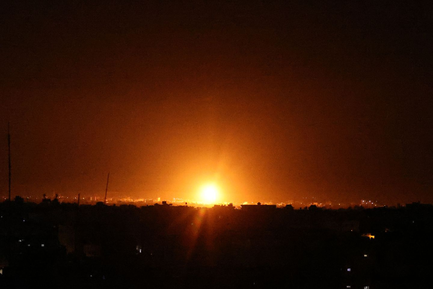 Explosions lit-up the night sky at Khan Yunis in the southern Gaza Strip, as Israeli forces shell the Palestinian enclave, early on June 16, 2021.