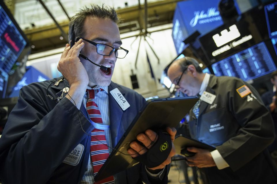 Traders and financial professionals worked on the floor of the New York Stock Exchange on Wednesday.
