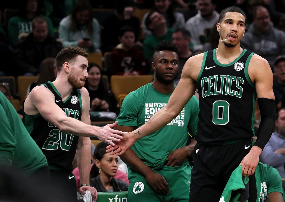 Gordon Hayward  (left) and Jayson Tatum (were both forced to take a seat after fouling out in the fourth quarter.