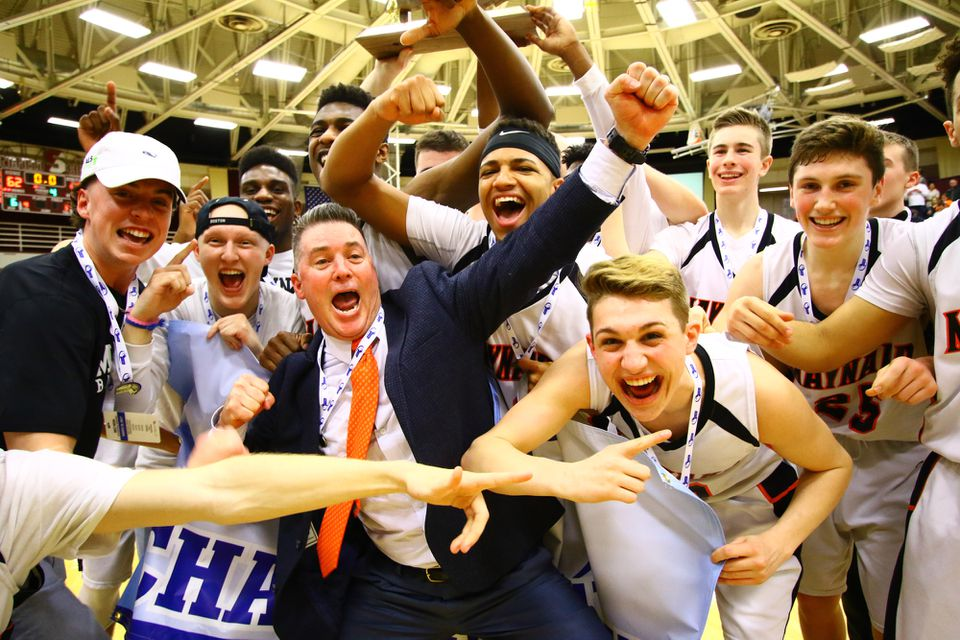 Maynard coach Paul Howes (center, orange tie) and his players celebrate their win over St. Mary's in the Division 4 state championship game Saturday at Springfield College.