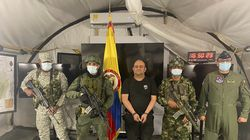 """In this photo released by the Colombian presidential press office, one of the country's most wanted drug traffickers, Dairo Antonio Usuga, alias """"Otoniel,"""" leader of the violent Clan del Golfo cartel, is presented to the media at a military base in Necocli, Colombia."""