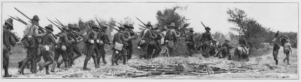 The US Army command of Colonel Summers marching to battle at Maasin (Moasin) in southern Leyte in the Philippines during the Philippine-American War in May 1899.