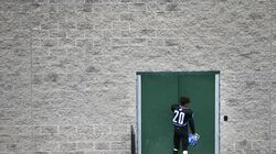 In this file photo, John D. O'Bryant player Nicholas Centeio heads back to the locker room at the end of a November 2019 game against Boston Latin Academy in the Boston City League North title game at Madison Park.
