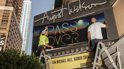 """A sign of progress: Workers update the marquee at the August Wilson Theatre on West 52nd Street for the play """"Pass Over,"""" which officially opens on August 4."""