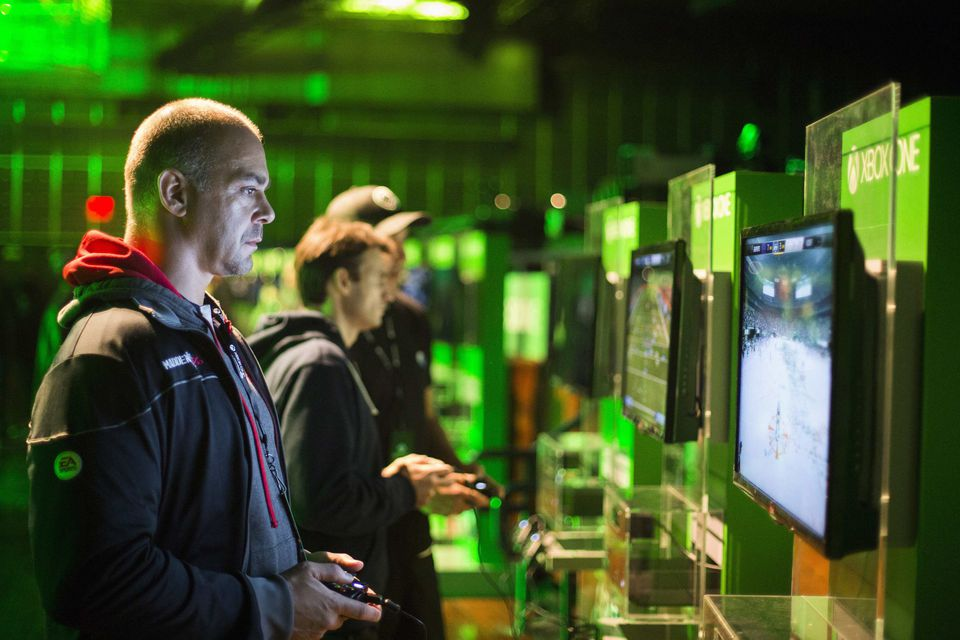 Fans played video games on Xbox One consoles during a midnight launch event in New York City last week.