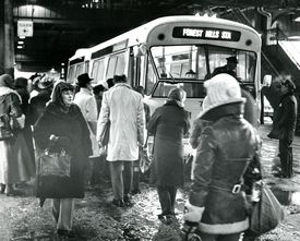 MBTA passengers boarded buses at Forest Hills in 1975.