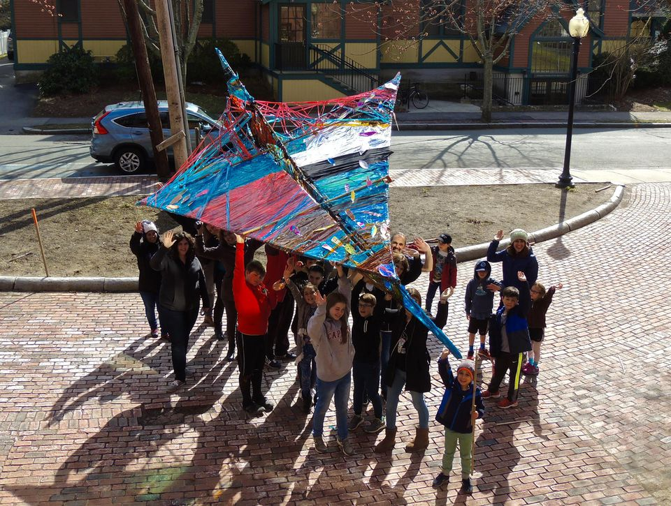 Students at the Arlington Center for the Arts, who are participating in the project, showed off an 18-foot-long prototype of the airplane. The full-size version is planned to be 64 feet long.