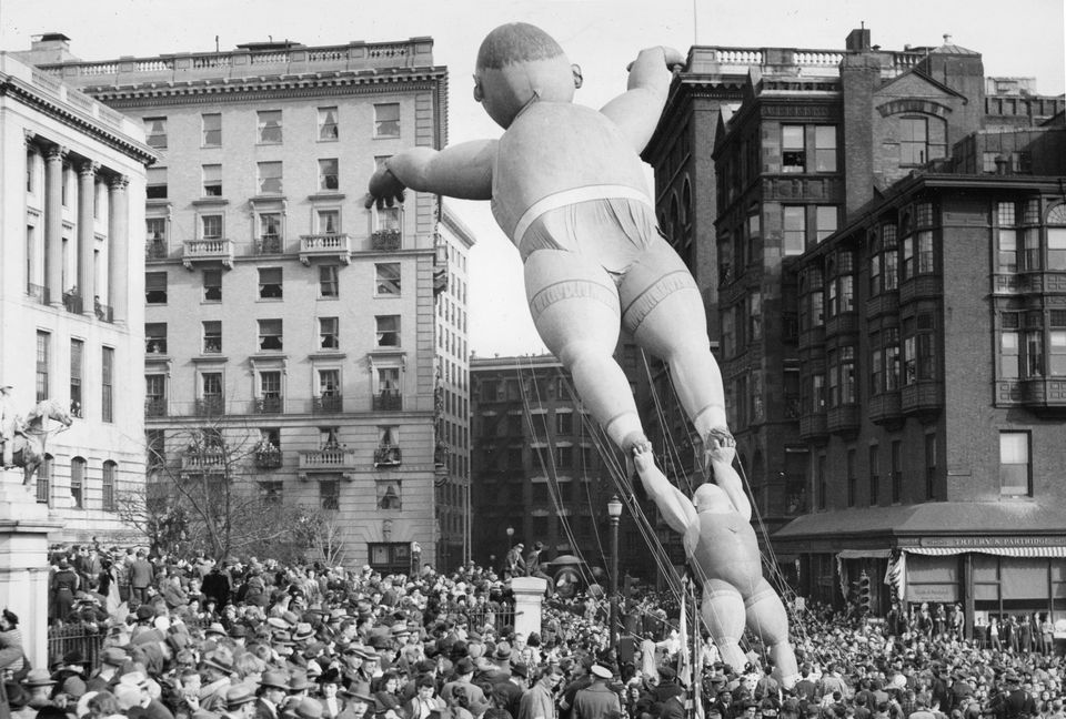 Acrobat balloons floated past the Massachusetts State House during the Santason parade in Boston on Thanksgiving Day, Nov. 20, 1941.