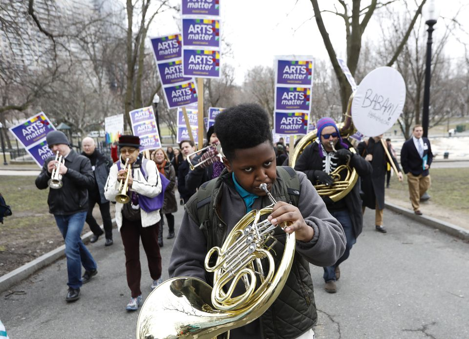 "A student from the Conservatory Lab Charter School played his French horn as he marched to the State House during what organizers called an ""Arts Matter Advocacy Day."""