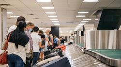 People waited for their luggage at an American Airlines baggage claim at the George Bush Intercontinental Airport in Houston in August. To cut down on stress, some people are just leaving the luggage at home instead.