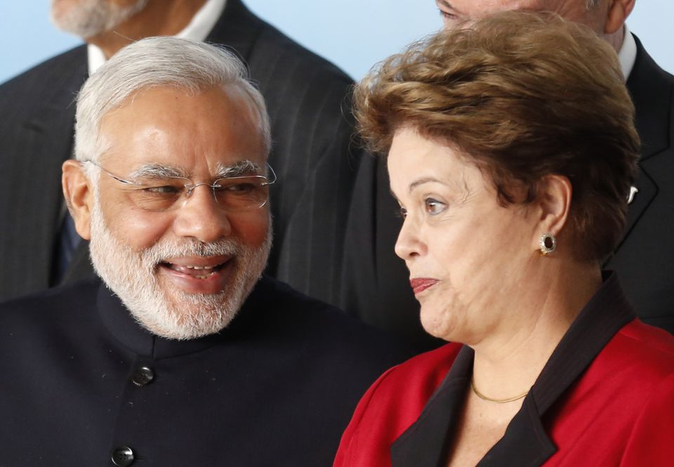 India's Prime Minister Narendra Modi (left) talked to Brazil's President Dilma Rousseff during a summit in Brasilia Wednesday.