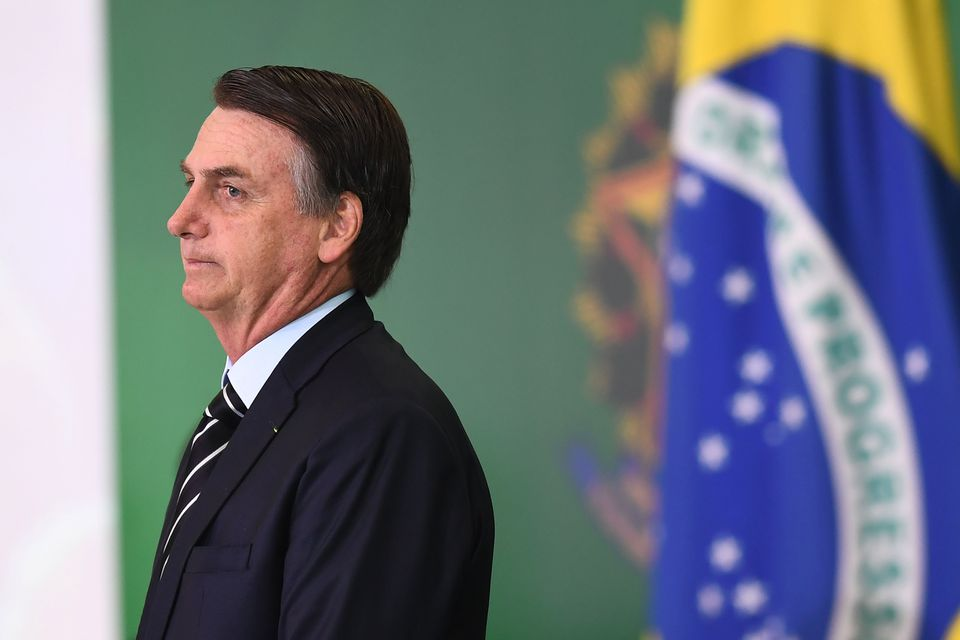 President Jair Bolsonaro of Brazil during a ceremony at Planalto Palace in Brasilia Wednesday in which some of the ministers of his Cabinet took office a day after the country's new government was sworn in.