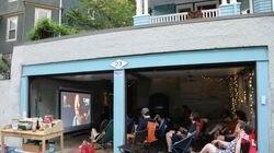 "Guests enjoy a movie (""Harriet"") at the Wenham Street Cinema, a community gathering spot that is really just Matt Shuman's garage in Jamaica Plain."