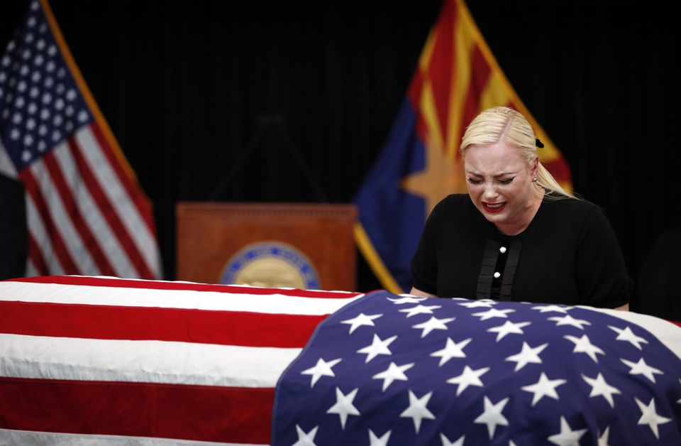 Meghan McCain, daughter of Senator John McCain, cried at his casket during a memorial service at the Arizona Capitol on Wednesday, Aug. 29, 2018.